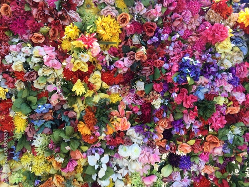 Obraz na plátně Full Frame Of Colorful Flowers On Gate