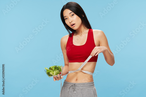 Photo Pretty woman Asian appearance and slim figure healthy eating meal