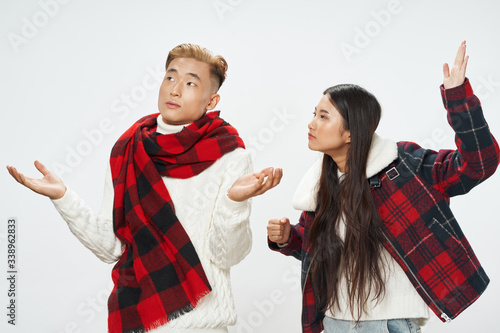 young couple Asian appearance and in a plaid scarf Studio cool Canvas Print