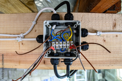 Exposed Wiring junction box half complete ready for operation in home garage Fotobehang