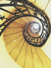 Directly Below Shot Of Yellow Spiral Staircase