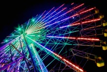 Low Angle View Of Illuminated Ferris Wheel At Night