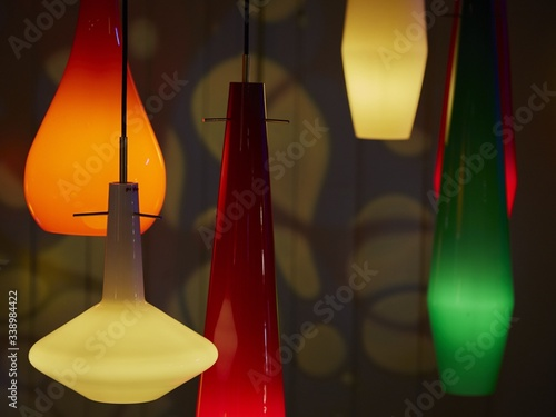Fotografie, Tablou Close-up Of Multi Colored Pedant Lights In House