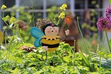 Bee Sculpture Amidst Plants In Park