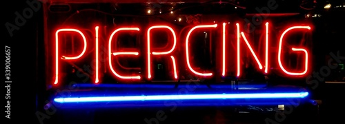 Close-up Of Neon Sign In The Dark - fototapety na wymiar