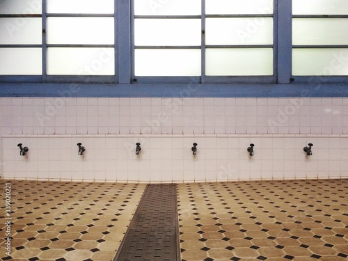Row Of Faucets For Traditional Muslim Ablution Wallpaper Mural