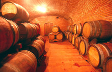 Barrels In Illuminated Wine Cellar