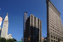 Low Angle View Of Flatiron Building And Modern Towers In City