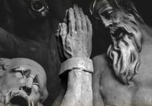 Close-up Of Pleading Statues On Charles Bridge