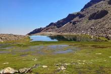 Lake At Beneath Of Mountain