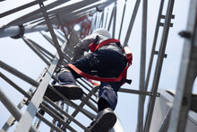 Engineer Wear Safety Equipment Climb High Telecom Tower For Maintenance 5G Network Working