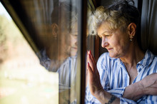 Sad Senior Woman Standing Indoors At Home, Corona Virus And Quarantine Concept.