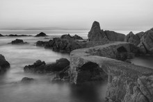 Stone Footbridge Leading To Rocky Coast