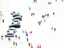 High Angle View Of People Walking On Snow Covered Field