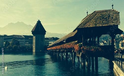 Fotografie, Obraz Chapel Bridge Across Reuss River Against Sky