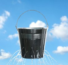 Leaky Bucket With Water Agains...