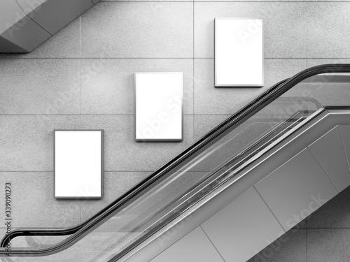 Fototapeta Side view of escalator on wall background with three blank light box