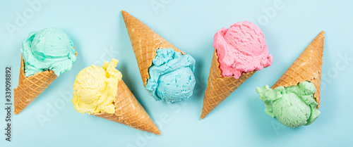 Fotografía Pastel ice cream in waffle cones, bright background, copy space
