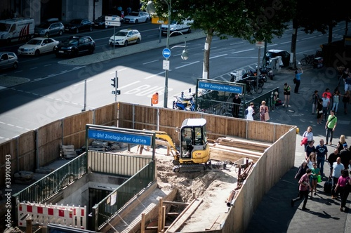 Fototapeta High Angle View Of People Walking On City Street By Construction Site