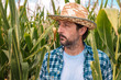 Leinwandbild Motiv Portrait of serious corn farmer in maize field