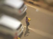 High Angle View Of Man Selling Bananas On Street