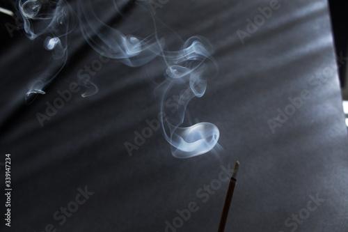 Obraz na plátně Abstract background of white smoke of incense stick into sun light spiritual eso
