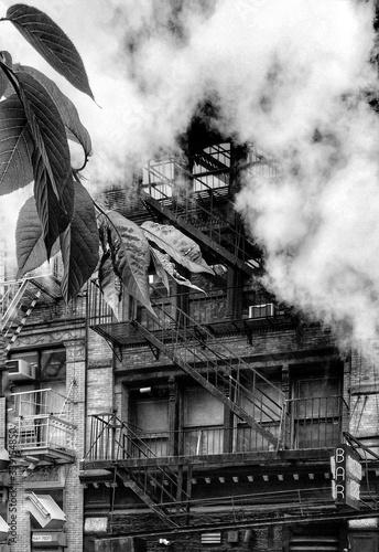 Fotografia, Obraz Low Angle View Of Fire Escape And Smoke