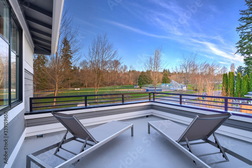 New luxury home with second floor deck balcony overlooking park in spring time in Seattle Canvas Print