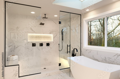 Papel de parede Detailes of the larhe walk in shower with white marble and mosaic, light