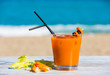 Carrot juice with the sea in the background