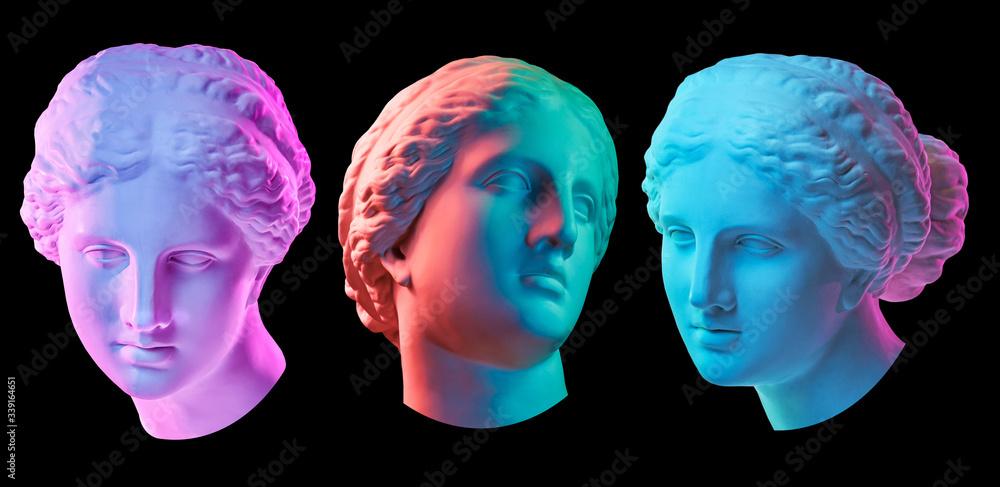Fototapeta Statue of Venus de Milo. Creative concept colorful neon image with ancient greek sculpture Venus or Aphrodite head. Webpunk, vaporwave and surreal art style. Isolated on a black.