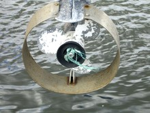 High Angle View Of Old Boat Propeller Over Water