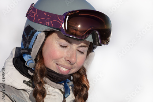 Fotografering portrait of a happy girl in equipment at a ski resort