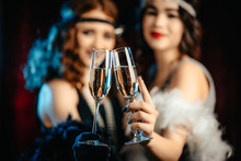 Beautiful Flappers Women Dressed In Style Of Roaring Twenties Drinking Champagne. Vintage, Retro Party, Fashion, Girls Friends Concept