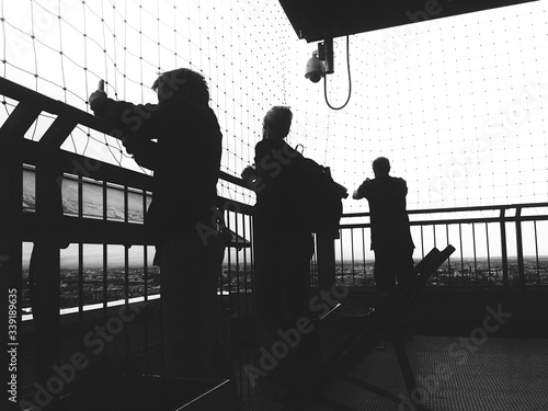 Canvas Print People Standing At Observation Deck With Net Against Sky
