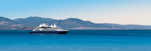 Side View Of Small Cruise Ship On The Aegean Sea. Panorama.