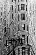 Old Gas Light Against Flatiron Building In City