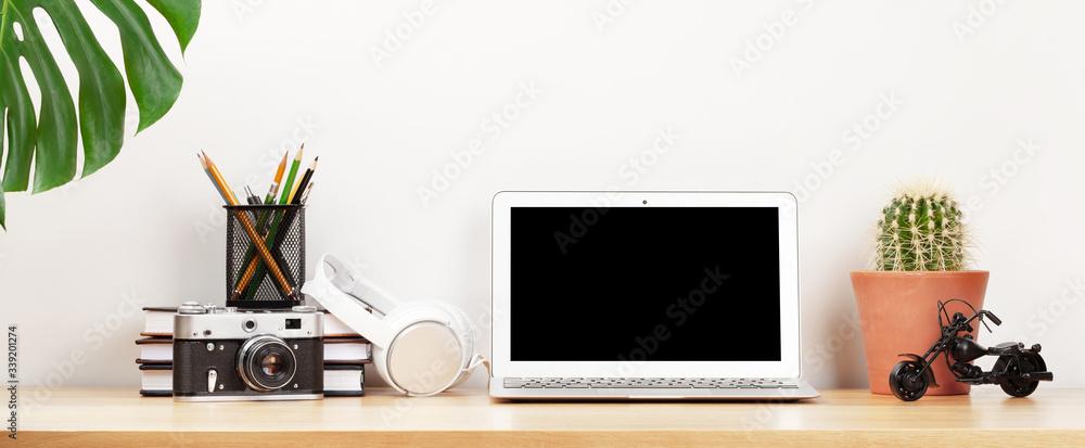 Fototapeta Home workspace with computer and headphones