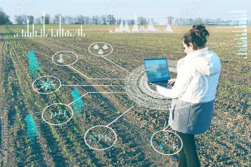 a farmer using a laptop and modern technology analyzes the data on humidity, tem Canvas Print