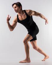Side View Of Athletic Man In Bodysuit Posing
