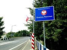 Signboard By Road Against Clear Sky At John Paul Ii Bridge