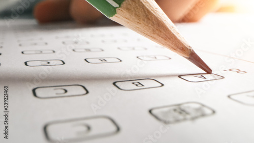 Fotomural On Exam Test Person Colors Right Answers with a Pencil