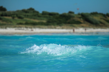 The detail of the sea wave in Rosignano in Italy. Famous white beach looks exotic and tropical.