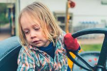 Little Boy Sitting On Old Trac...