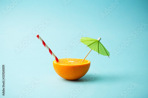 Food summer minimal concept. Orange juice and juicy tropical fruits on a light colored background - 339260019
