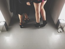 Low Section Of Women Standing On Floor