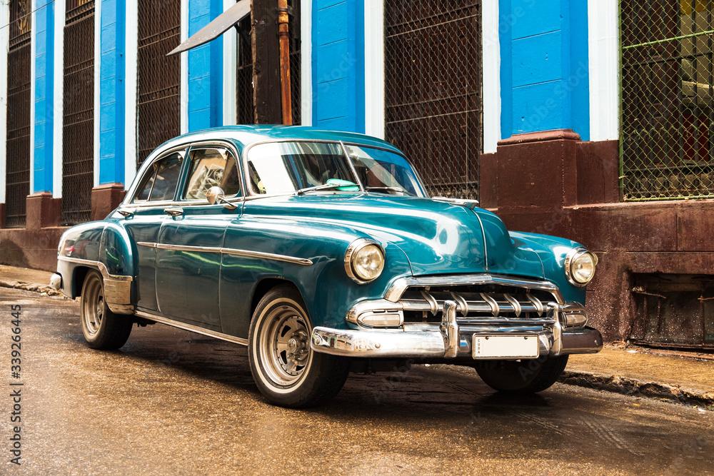 Fototapeta old blue vintage classic american car in the street of havana cuba