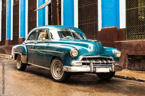 old blue vintage classic american car in the street of havana cuba Wallpaper Mural