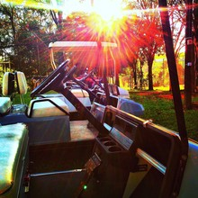Sunlight Falling On Empty Golf Carts At Course