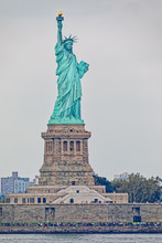 Statue Of Liberty On Liberty Island During The Gloomy Weather In New York.